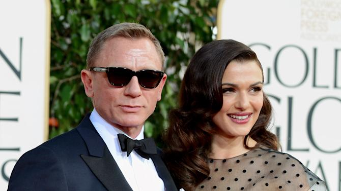 Actors Daniel Craig, left, and Rachel Weisz arrive at the 70th Annual Golden Globe Awards at the Beverly Hilton Hotel on Sunday Jan. 13, 2013, in Beverly Hills, Calif. (Photo by Jordan Strauss/Invision/AP)