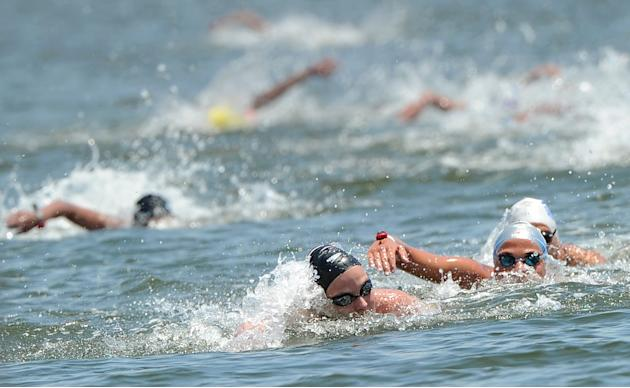 Gold medal winner Britain's Keri-Anne Payne (C-front) is chased by silver medal winner Italy's Martina Grimaldi (R) during the women's 10km open water swimming event of the FINA World Cham