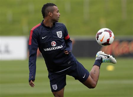 England's Cole stretches for a ball during a training session at the St George's Park training complex near Burton upon Trent