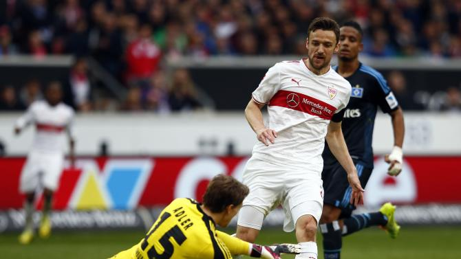 Stuttgart's Gentner is challenged Hamburg's Rene Adler during their German first division Bundesliga soccer match in Stuttgart