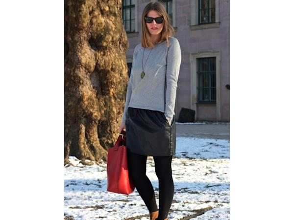 Images via : iDiva.com A leather skirt paired with a simple tee and ankle booties steer this outfit into the causal category. Check out the hottest winter coats here . Source: StylePile Related Articl