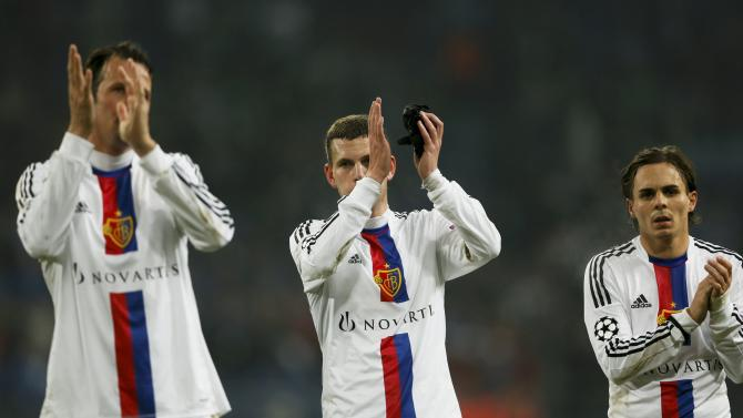 FC Basel's players applaud after their Champions League group E soccer match against Schalke 04 in Gelsenkirchen