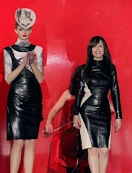 Portuguese designer Fatima Lopes (R) acknowledges the public during the Fall/Winter 2012-2013 ready-to-wear collection show in Paris