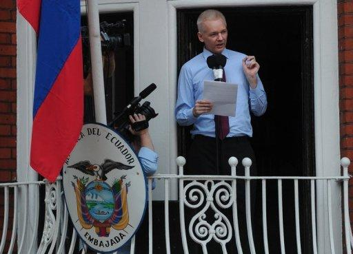 In this file picture taken in August 2012 Wikileaks founder Julian Assange addresses the media and his supporters from the balcony of the Ecuadorian Embassy in London. Assange has a lung condition that could get worse, the South American country's envoy to Britain said.