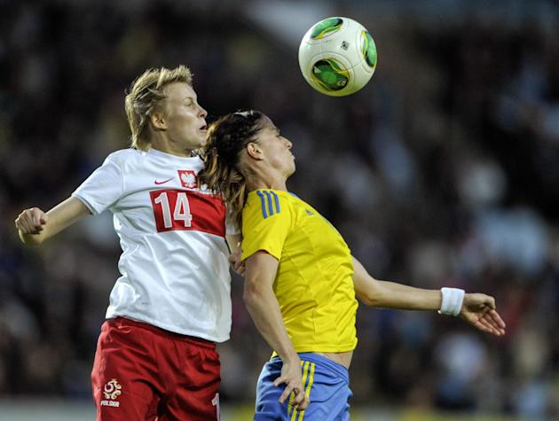 Poland's Jolanta Siwinska, left, during a header duel with Sweden's Lotta Schelin in the ladies' football World Championships qualification match at Swedbank Stadium in Malmo, Sweden, Saturday Septemb