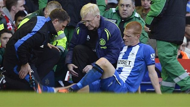 Wigan Athletic's Ben Watson (R) is treated for a broken leg during their English Premier League soccer match against Liverpool in Liverpool, northern England November 17, 2012.