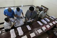 Egyptian election officials count ballots at a polling station in Cairo, May 24. Vote counting was underway in Egypt Friday after two days of polling in a landmark presidential election which pitted stability against the ideals of the uprising that ended Hosni Mubarak's rule