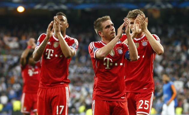 Bayern's Jerome Boateng, Philipp Lahm and Thomas Mueller, from left, acknowledge the fans after losing 0-1 in a  Champions League semifinal first leg soccer match between Real Madrid and Bayern Mu