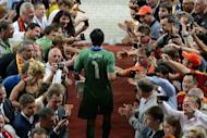 Italian goalkeeper Gianluigi Buffon is congratulated by fans at the end of the Euro 2012 football championships final match Spain vs Italy at the Olympic Stadium in Kiev. Spain won 4-0