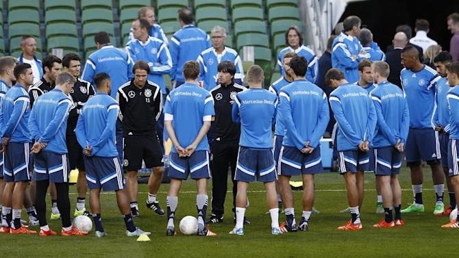 Germany coach Joachim Low speaks to his players during training
