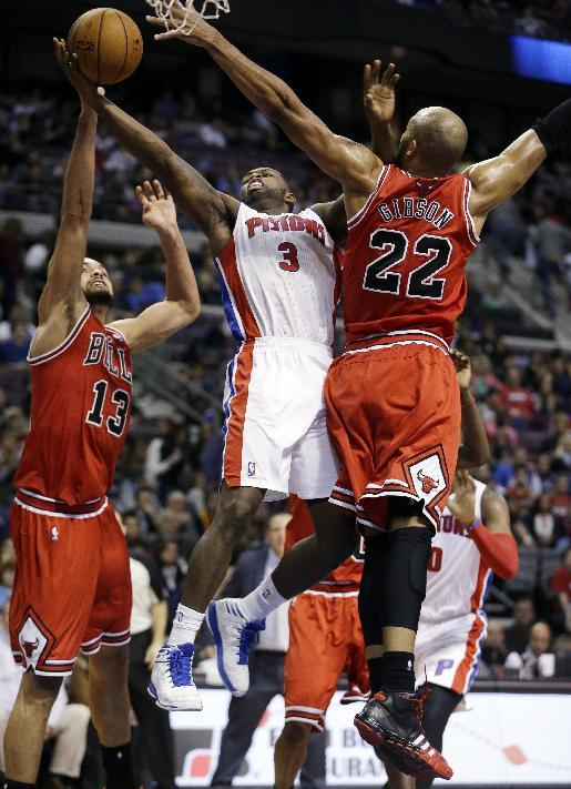 Detroit Pistons shooting guard Rodney Stuckey (3) shoots between Chicago Bulls center Joakim Noah (13) and forward Taj Gibson (22) during the second half of an NBA basketball game in Auburn Hills, Mich., Wednesday, Nov. 27, 2013