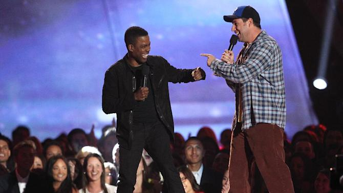 Actors Adam Sandler, right, and Chris Rock present the award for best WTF moment at the MTV Movie Awards in Sony Pictures Studio Lot in Culver City, Calif., on Sunday April 14, 2013. (Photo by Matt Sayles/Invision /AP)