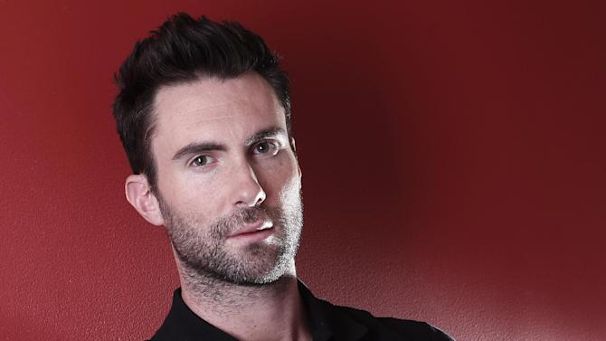 "In this Feb. 20, 2012 photo, musician Adam Levine poses for a portrait in New York. Levine, the frontman for the band Maroon 5,  also serves as a coach on the TV singing competition series, ""The Voice"" airing Mondays on NBC. (AP Photo/Carlo Allegri)"
