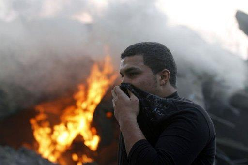 A Palestinian covers his face after an Israeli air strike on Gaza City. A senior Islamic Jihad militant was killed in an Israeli strike on a Gaza City building housing Palestinian and international media, the Islamist faction told AFP