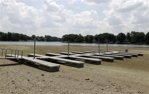 An empty dock sits on the bottom of a dry cove at Morse Reservoir in Noblesville, Ind., Monday, July 16, 2012. The reservoir is down nearly 6 feet from normal levels and being lowered 1 foot every five days to provide water for Indianapolis. (AP Photo/Michael Conroy)