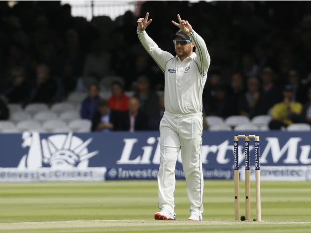 New Zealand's Brendon McCullum holds up his hands as plays starts on the second day of the first Test match at Lord's cricket ground in London, Friday, May 22, 2015. (AP Photo/Kirsty Wiggleswo