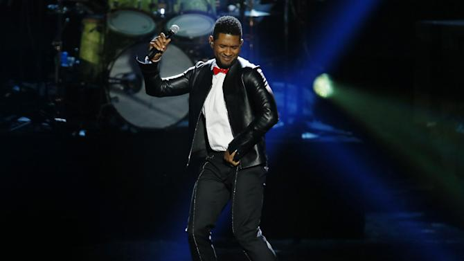 Usher performs a Michael Jackson song as producer Quincy Jones is inducted into the Rock and Roll Hall of Fame during the Rock and Roll Hall of Fame Induction Ceremony at the Nokia Theatre on Thursday, April 18, 2013 in Los Angeles. (Photo by Danny Moloshok/Invision/AP)