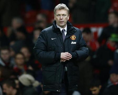 Manchester United manager David Moyes walks back to the dressing rooms after their English Premier League soccer match against Fulham at Old Trafford in Manchester