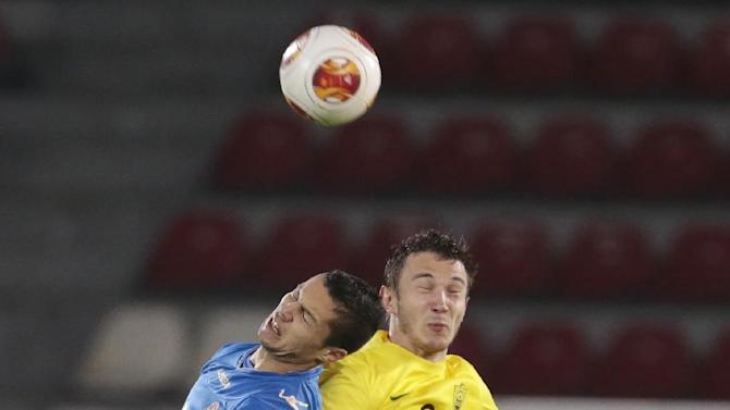 Tromso's Hendrik Helmke, left, Anzhi's Nikita Burmistrov and Alan Gatagov, bottom, struggle for the ball during the Europa League group K soccer match between Anzhi Makhachkala and Tromso IL at Saturn stadium in Ramenskoye, outside Moscow, in Russia, on Thursday, Oct. 24, 2013