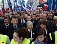 The leader of the Law and Justice party (PiS), Jaroslaw Kaczynski (C), demonstrates in Warsaw against Poland's centrist government