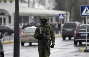 An armed man patrols at the Simferopol airport in the…