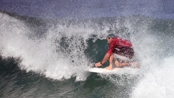 Austalian Joel Parkinson rides a wave to finishes second behind US John John Florence, of Hawaii, during the final of the Association of Surfing Professionals' men's 2012 ASP World Championship Tour at Barra da Tijuca beach in Rio de Janeiro, Brazil, on May 16, 2012. Florence won the competition.  AFP PHOTO/Christophe SIMONCHRISTOPHE SIMON/AFP/GettyImages