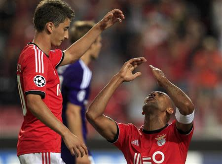 Benfica's Luisao celebrates with fellow team scorer Djuricic after scoring his side's second goal against Anderlecht during their Champions League soccer match at the Luz Stadium in Lisbon