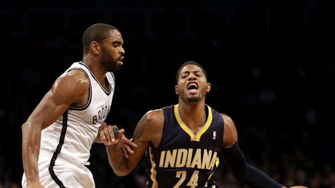 Indiana Pacers' Paul George, right, pushes past Brooklyn Nets' Alan Anderson during the first half of an NBA basketball game Monday, Dec. 23, 2013 in New York