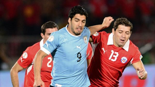 World Cup - Suarez escapes punishment for punch