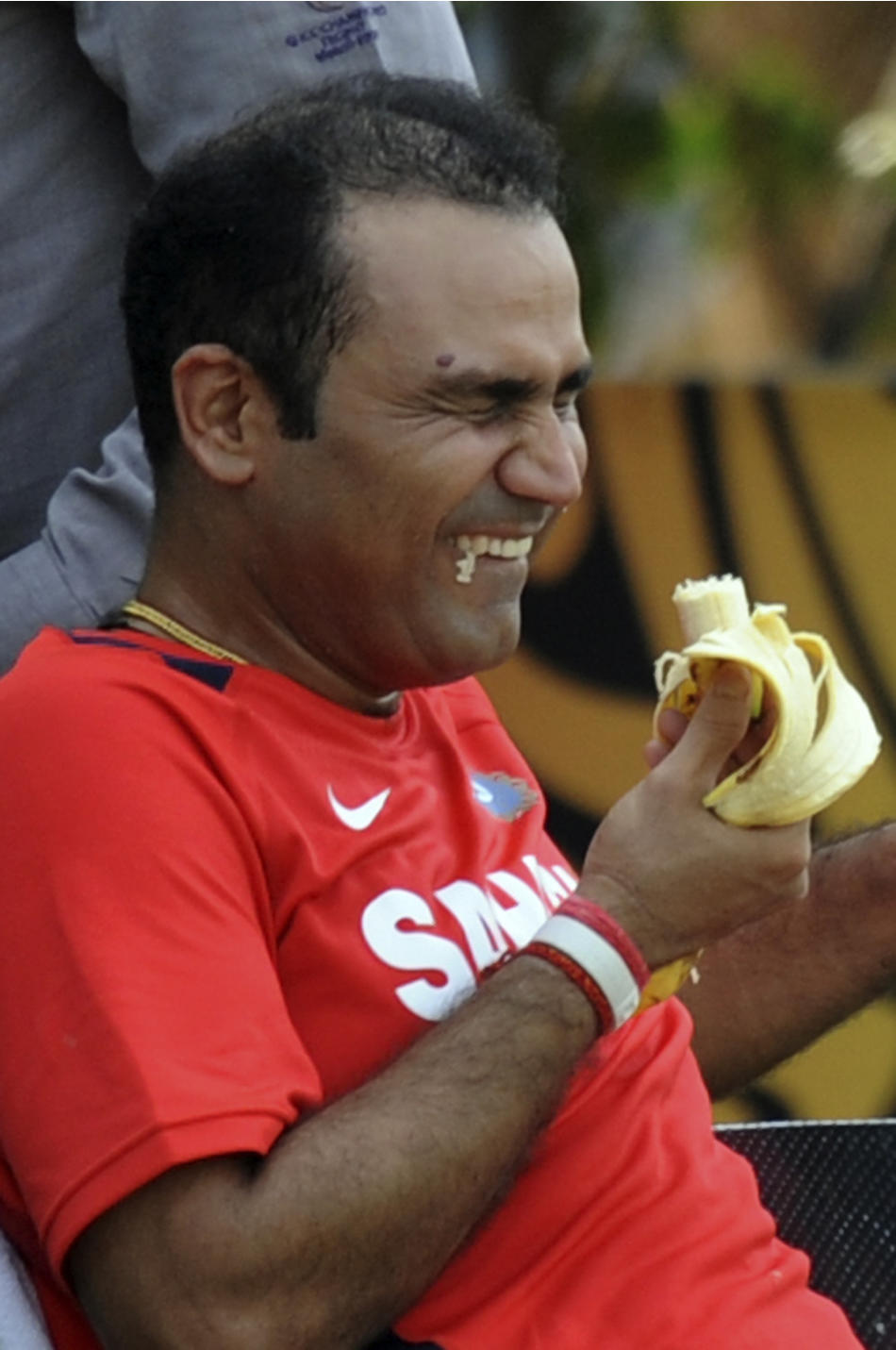 Indian cricketer Virender Sehwag reacts