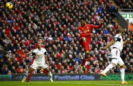 Liverpool's Daniel Sturridge scores his second goal against Swansea during their English Premier League soccer match in Liverpool