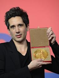 "French director Jean-Bernhard Marlin poses with the Golden Bear award for best film of the international short film jury for ""La Fugue"" (""The Runaway"") at a press conference after the awards ceremony of the 63rd Berlinale Film Festival, in Berlin on February 16, 2013"