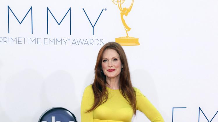 "Julianne Moore arrives at the 64th Primetime Emmy Awards at the Nokia Theatre on Sunday, Sept. 23, 2012, in Los Angeles. Moore is nominated for best actress in a miniseries or movie for her role as Sarah Palin in ""Game Change."" (Photo by Matt Sayles/Invision/AP)"