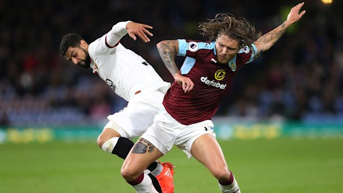 Watford's Miguel Britos in action with Burnley's Jeff Hendrick