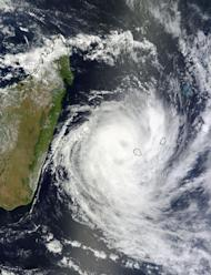 This visible image of Tropical Cyclone Dumile over La Reunion Island and Mauritius was captured by the MODIS instrument aboard NASA's Terra satellite on Jan. 3, 2013, at 0650 UTC. Dumile's center was just northwest of Reunion (left) and Mauriti