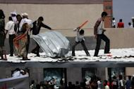Yemeni protesters try to break through the US embassy in Sanaa during a protest over a film mocking Islam on September 13. The US embassy in Yemen has suspended all consular services for two weeks, the mission said in a statement on its website, after four people were killed in violent anti-American protests in Sanaa