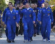 Crew members of the next expedition to the International Space Station, (from left) US astronaut Kevin Ford, Russian cosmonauts, Oleg Novitskiy and Evgeny Tarelkin walk to a bus during a sending-off ceremony in the Russian-leased Baikonur cosmodrome on October 23. A Russian rocket carrying two Russians and an American has blasted off for the ISS
