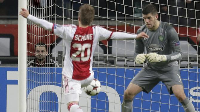 Celtic goalkeeper Fraser Forster, right, saves ahead of Ajax's Lasse Schone during the Champions League Group H soccer match between Ajax Amsterdam and Celtic Glasgow at ArenA stadium in Amsterdam, Netherlands, Wednesday, Nov. 6, 2013