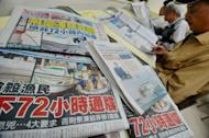 Newspapers in New Taipei City carry the story of a Taiwanese fisherman shot by Filipino coastguards, May 12, 2013. Taiwan has dispatched four coastguard and naval vessels to beef up patrols in waters near the Philippines following public outrage over the shooting