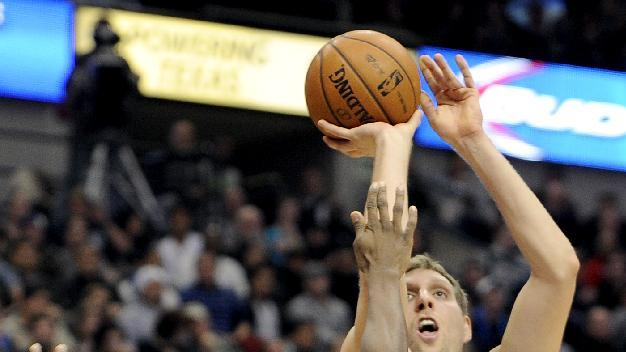 Dallas Mavericks power forward Dirk Nowitzki (41) shoots over Golden State Warriors small forward Harrison Barnes (40) in the first half during an NBA basketball game on Wednesday, Nov. 27, 2013, in Dallas