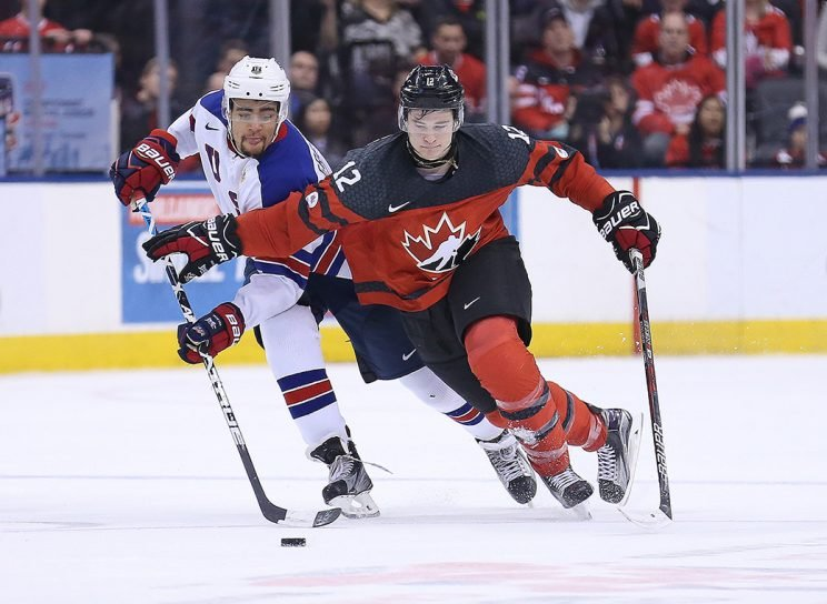 TORONTO,ON - DECEMBER 31: Jordan Greenway #12 of Team USA looks to steal a puck from Julien Gauthier #12 of Team Canada during a preliminary round game in the 2017 IIHF World Junior Hockey Championship at the Air Canada Centre on December 31, 2016 in Toronto, Ontario, Canada. The USA defeated Canada 3-1. (Photo by Claus Andersen/Getty Images)
