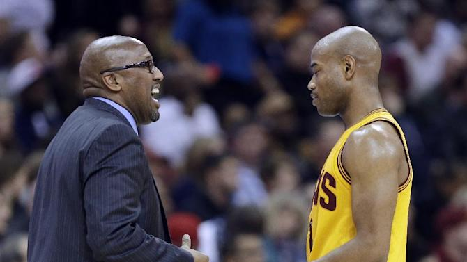 Cleveland Cavaliers head coach Mike Brown, left, talks with Jarrett Jack in the fourth quarter of an NBA basketball game against the Miami Heat Wednesday, Nov. 27, 2013, in Cleveland. The Cavaliers lost to Miami 95-84