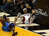 LeBron James (R) of the Miami Heat and Kevin Durant (L) of the Oklahoma City Thunder take a fall during Game 3 of the NBA Finals on June 17, 2012 at the American Airlines Arena in Miami, Florida. The Heat won 91-85 to take a 2-1 lead in the best-of-seven series