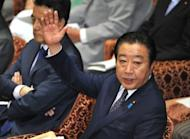 Japan's Prime Minister Yoshihiko Noda attends a lower house committee session in Tokyo on Tuesday. Japan's lower house of parliament on Tuesday approved a controversial bill to double sales tax, despite a rebellion from lawmakers in the governing party