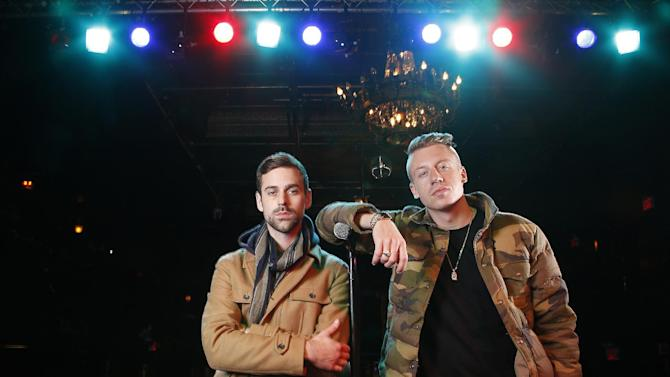 "FILE - In this Nov. 20, 2012 file photo, American musician Ben Haggerty, better known by his stage name Macklemore, right, and his producer Ryan Lewis pose for a portrait at Irving Plaza in New York.  Macklemore & Ryan Lewis feat. Wanz, ""Thrift Shop"" is the number one top streamed track for the United States on Spotify from Monday, Feb. 11, to Sunday, Feb. 17, 2013. (Photo by Carlo Allegri/Invision/AP, File)"