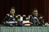 Malaysia Airlines representatives speak at a news conference about information on Malaysia Airlines flight MH370, at a hotel in Beijing March 9, 2014. REUTERS/Jason Lee