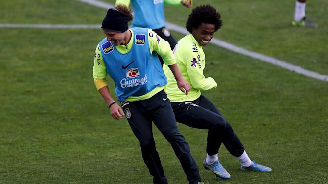 Brazil's players David Luiz and Willian attend a team training session, ahead of their 2018 World Cup qualifying soccer match against Chile on Thursday, in Santiago