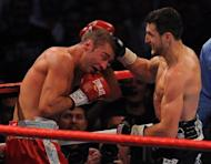 Carl Froch (R) dismantled Canada-based Romanian Lucian Bute in five rounds to win the International Boxing Federation belt in May. A return fight has been discussed for Montreal on March 30