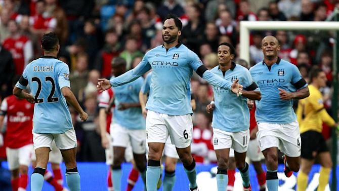 Joleon Lescott, centre, celebrates scoring Manchester City's goal against Arsenal