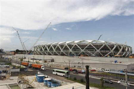 The Arena Amazonia stadium is under construction to host several 2014 World Cup soccer games, in Manaus December 14, 2013. REUTERS/Bruno Kelly